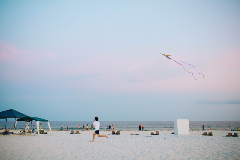 Boy running with a kite.