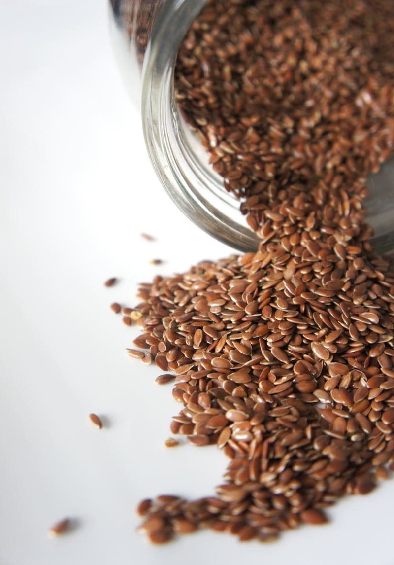 Brown seeds in a glass bottle.