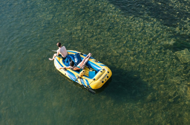 calm water rafting in an inflatable raft