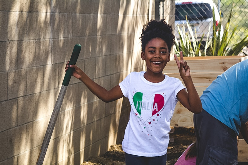 girl with shovel at Fletcher Elementary School