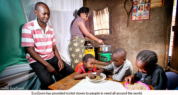 family enjoying food cooked on EcoZoom rocket stove