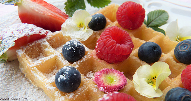 waffles sprinkled with fruit and edible flowers