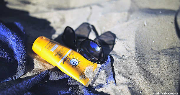 Sunscreen bottle in the sand