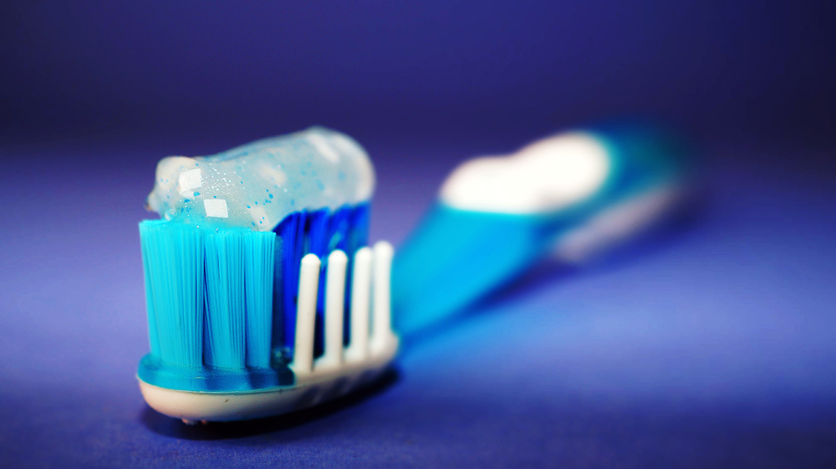 toothpaste with microbeads on plastic toothbrush